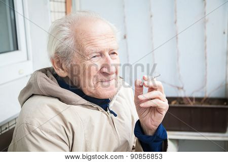 Old Man Smoking A Cigarette