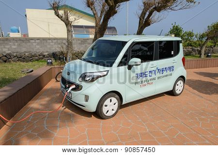 Jeju-do, Korea - April 10, 2015: Recharging Kia Ray Ev Electric Car
