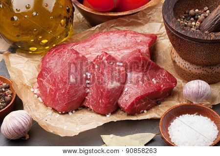 Raw fillet beef steak and spices closeup