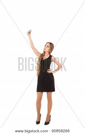 Girl In A Black Short Dress On A White Background..girl Photographing Selfe.