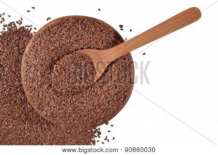 Linseed In A Wooden Bowl On A White