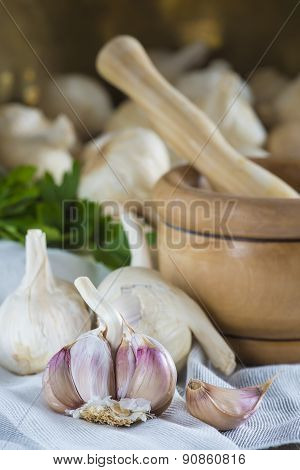 Garlic For Cooking On The Table Of The Kitchen