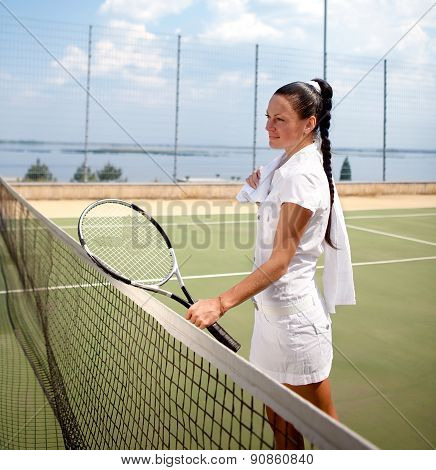 Young woman on a tennis court