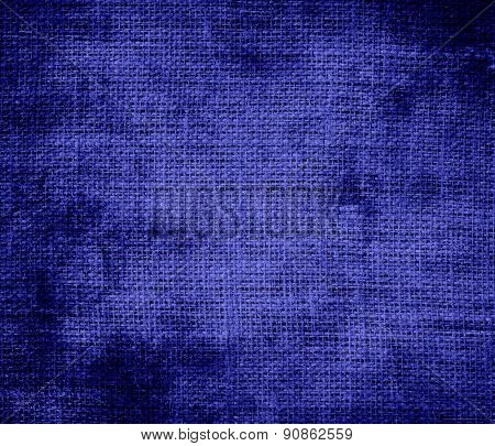 Grunge background of blue (pigment) burlap texture