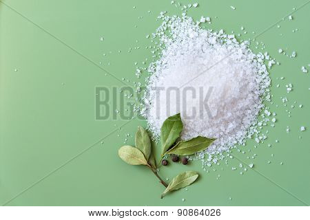 Sea salt with bay leaves, top view
