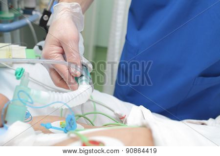 Doctor Works With Patient In The Intensive Care Unit