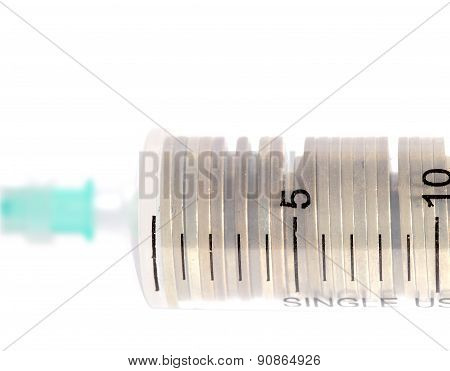 Stack Of Coins In The Medical Syringe