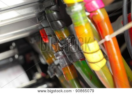 Tubes with different colored ink in the printing machine