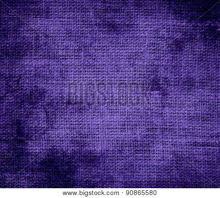 Grunge background of blue-magenta violet burlap texture