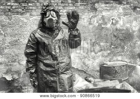Man With Gas Mask And Green Military Clothes  Explores   Dead Bi