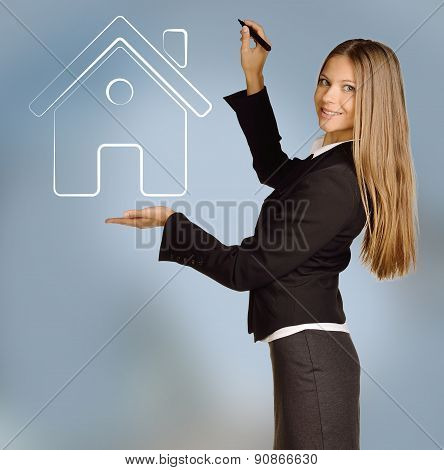 Young girl shows house icon drawing pen tool