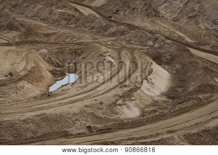Off-road track on the rural road in the sandy quarry
