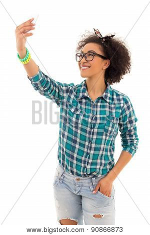 Beautiful African American Teenage Girl Taking A Picture Of Herself With Her Camera Phone Isolated O