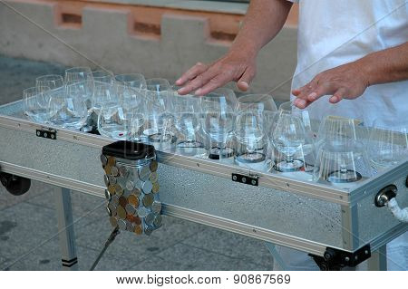 Street Musician Playing On Glass Harp