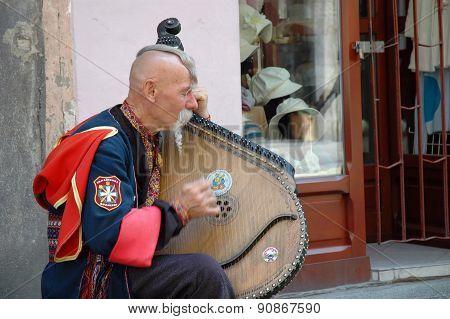 Ukrainian Cossak Playing On His Bandura Instrument