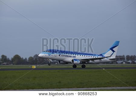 Amsterdam Airport Schiphol - Embraer Erj-170 Of Estonian Air Takes Off