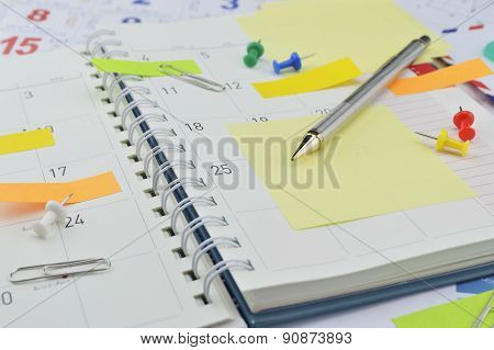 Pencil With Post It Notes And Pin On Business Diary Page