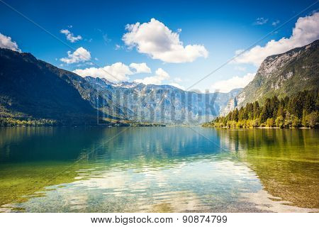 Fantastic mountain lake in Triglav national park. Located in the Bohinj Valley of the Julian Alps. Dramatic unusual scene. Slovenia, Europe. Beauty world.