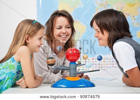 Kids having fun studying the solar system - science is fun concept