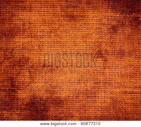 Grunge background of burnt orange burlap texture