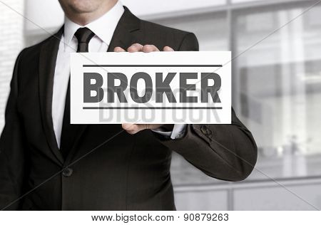 Broker Sign Is Held By Businessman.