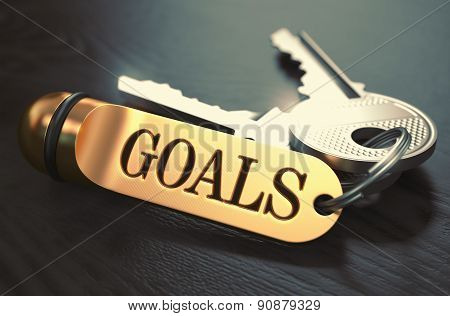 Goals - Bunch of Keys with Text on Golden Keychain.