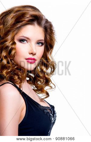 Beautiful young sexy woman in black dress with curly hair - isolated on a white background