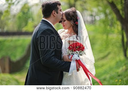 Wedding Couple, Kisses On The Forehead