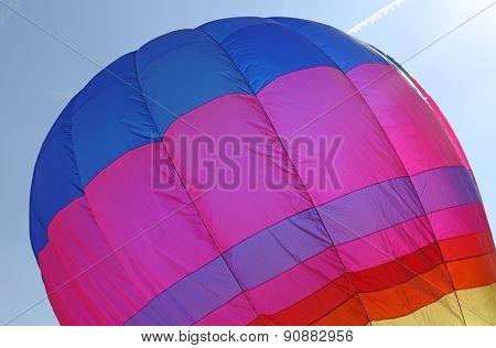 Hot Air Balloon Flies In Sky Blue