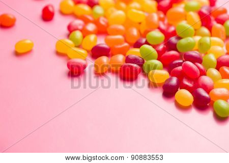 the jelly beans on pink background