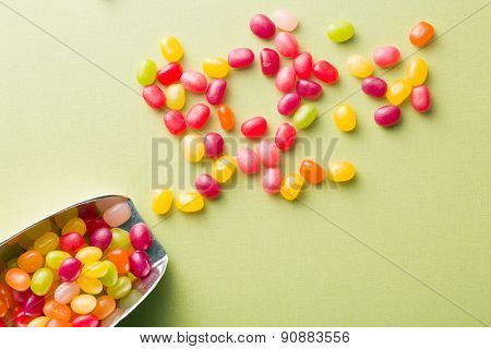 the jelly beans on green table