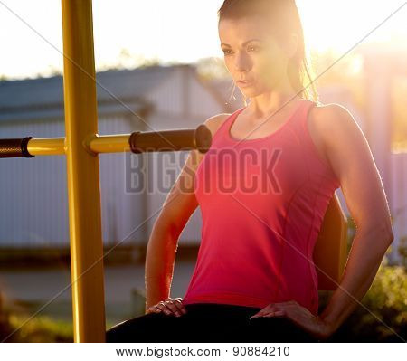 Woman In Deep Concentration On Exercising Outside.