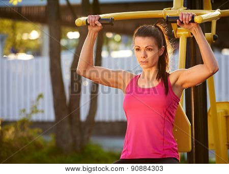 Woman In Deep Concentration While Exercising.
