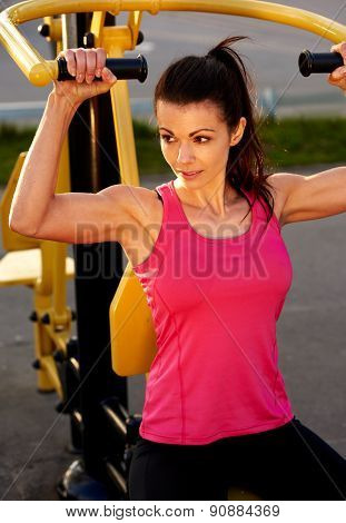 Muscular Woman Exercising Upper Body.