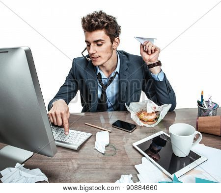 Guy With Paper Plane In His Hand Typing On A Computer Keyboard / Modern Office Man At Working Place,