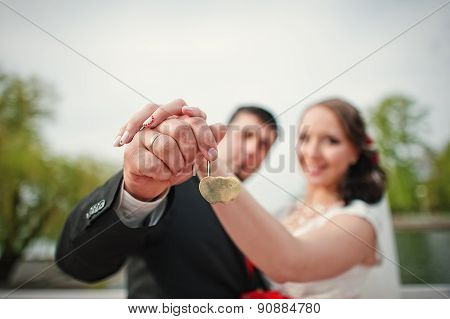 Hands Wedding Couple With Lock And Rings