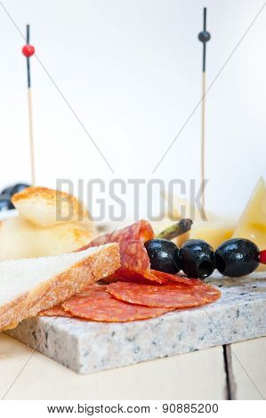 Mix Cold Cut On A Stone With Fresh Pears