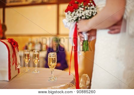 Glass Of Champagne At The Table Newlywed