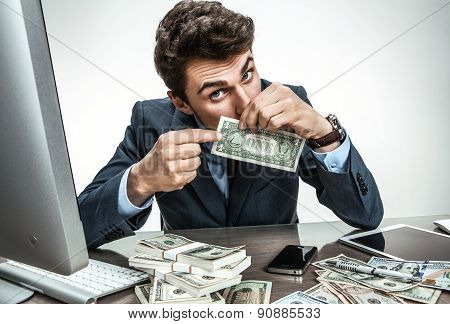 Bemused Businessman Dissatisfied With His Earnings, Profit, Income, Gain, Benefit, Margin