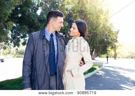 Portrait of a smiling beautiful couple dating in park