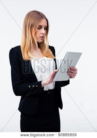 Young businesswoman using tablet computer over gray background