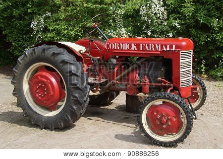Old vintage Agriculture Red Tractor- MC Cormick Farmall