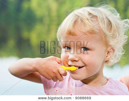 Blonde Girl Brushing Teeth