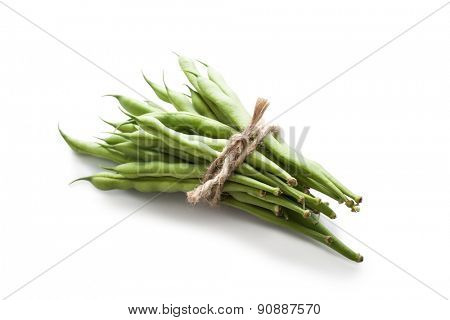 bunch of green beans tied with rope on white