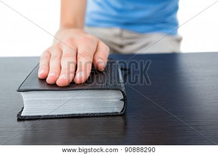 Woman praying with bible on white background