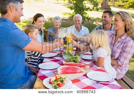 Happy family having picnic in the park on a sunny day