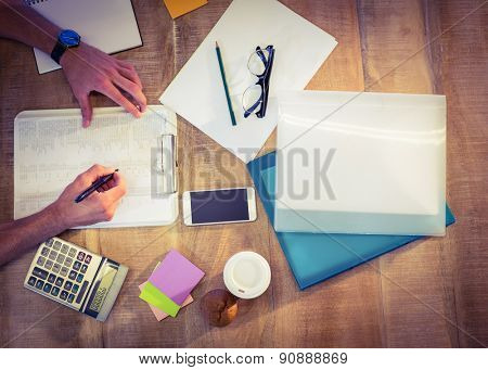 Designer working at desk overhead shot in creative office
