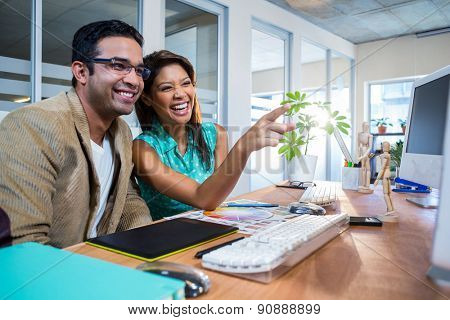 Happy partners laughing together in the office