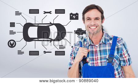 Confident plumber holding tool over white background against grey vignette