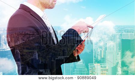 Businessman using his tablet pc against new york
